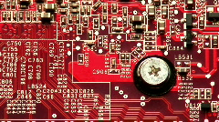Magnifying glass passes across computer circuit board - stock footage