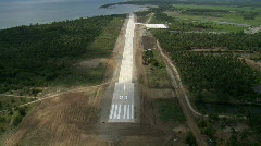 Aerial approach of a rural airstrip - stock footage