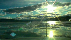Ice racing driver's view sunset sky reflection Stock Footage