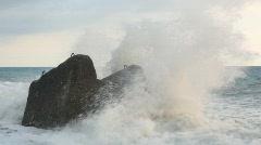 Sea surf waves break against the rock Stock Footage
