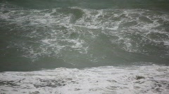 Big waves of dark sea in storm, dull weather Stock Footage