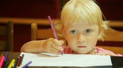 Portrait of little girl drawing pencils on white paper Stock Footage