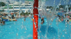 People in water park, focus on falling water in foreground Stock Footage