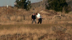 Golfers Swing Their Clubs Stock Footage