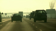 Cars and trucks Drive Down a Busy Highway Stock Footage