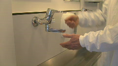 Medical physician washes hands using soap Stock Footage