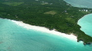 Aerial of tropical island peninsula Stock Footage