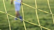 Soccer through the goal net 3 Stock Footage