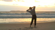 Stock Video Footage of Businessman at sunrise on a beach