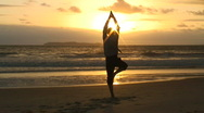 Stock Video Footage of Businessman doing yoga at sunrise