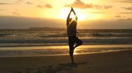 Businessman doing yoga at sunrise Stock Footage