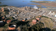 Stock Video Footage of Aerial view of  oceanside oil refinery