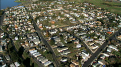 Aerial view of suburbs & oil refinery Stock Footage