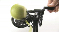 Stock Video Footage of Peeling A Green Granny Smith Apple With An Antique Appliance