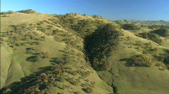 Aerial view of unspoiled green undulating hillside Stock Footage