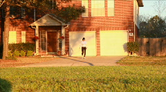 Woman jogging from her house Stock Footage