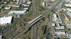 Stock Video Footage of Aerial view of freeway with shopping malls & sporting areas