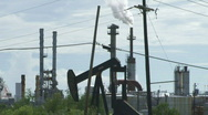 Stock Video Footage of Oil Pump, Electric Lines, and Smoke Stacks