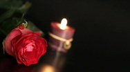 Red rose and candle. Stock Footage