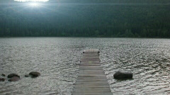 Kids swimming in mountain lake - stock footage