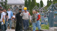Priest and worker at Merry Cemetery, Sapanta, Romania Stock Footage