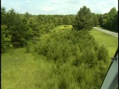 Stock Video Footage of 2 shots of helicopter skimming tree tops and river