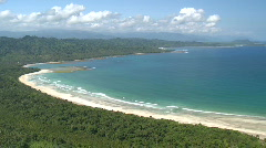 Aerial over beautiful tropic beach with forest in the background Stock Footage