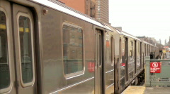 MTA Subway Train Departing Elevated Station Outside Harlem New York City NYC Stock Footage