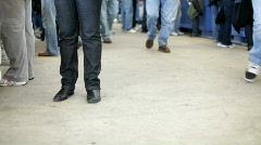 Feet standing and waiting while others walk by Stock Footage
