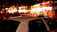 Police Car with lights on in mardi gras parade Stock Footage