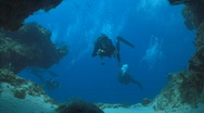 Diver swimming into cave Stock Footage