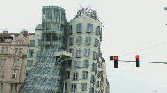 WS, Stoplight next to modern building, Dancing House aka 'Ginger and Fred', Prag Stock Footage