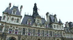 Wide shot, Pan down, Ice skaters in front of Hotel de Ville, Paris, France Stock Footage