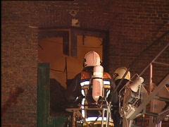 Firefighters on elevator Stock Footage