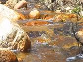Desert River flows through the desert Stock Footage