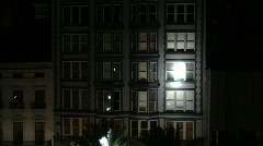 Spot lights on apartment building Stock Footage