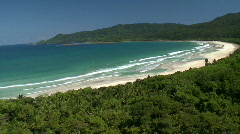 Aerial over beautiful tropic beach with forest in the background - stock footage