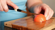 Cutting of tomato for salad. Stock Footage