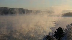 Clouds of steam rise over a freezing river  Stock Footage
