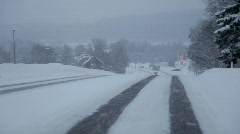 Driving through a Swedish village on a snowy winter day. Stock Footage