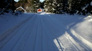 Skiing down a hill through a Swedish forest. Stock Footage