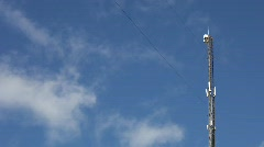 Cell phone tower with drifting clouds. Stock Footage