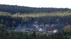 A fire burns at a Swedish farm situated in the forest. Stock Footage