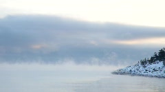 Vapours are rising from the freezing water of a bay  Stock Footage