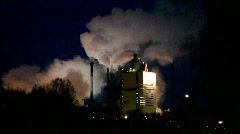Columns of smoke billow from factory chimneys. Stock Footage