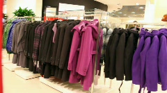 Hangers with clothes and shelves with bags Stock Footage