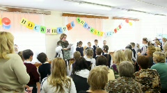 Children read oaths at dedication meeting in first-graders of school number 1349 - stock footage