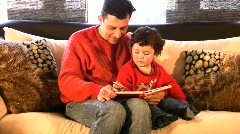 Dad and his son With a Puzzle   Full HD 1080p Stock Footage