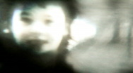 Eerie girl running up close - Vintage 8mm Film footage Stock Footage