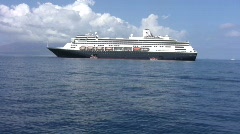 Stock Video Footage of Blue Cruiseship anchored